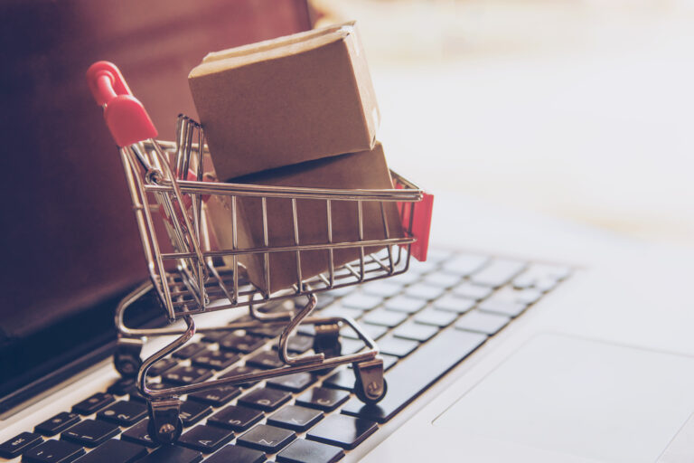 Shopping trolley/cart above a laptop keyboard